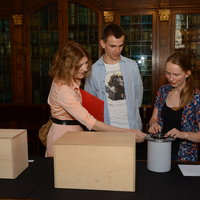 Visitors with a musical box, an adaptation of a musical clock featuring a parade of JU rectors