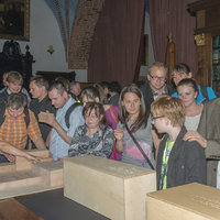 Visitors touching the mock-ups of the Collegium Maius building and those of the vaults in its selected chambers